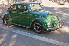早期绿色1966年大众甲壳虫汽车 免版税库存照片