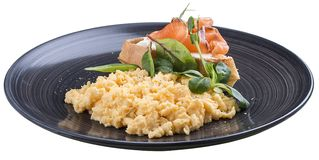 早餐与三文鱼的炒蛋 免版税库存图片