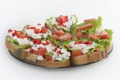 早餐牌照准备好的三明治 图库摄影