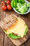 早餐百吉卷(用乳酪;选择聚焦) 库存图片