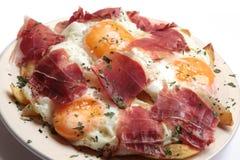 早餐鸡蛋油煎了火腿 库存图片