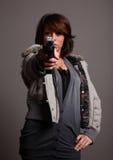 时兴的枪妇女 库存照片