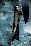 时尚军事称呼 塑造在夹克、裙子和起动摆在 免版税库存照片