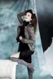 时尚军事称呼 塑造在夹克、裙子和起动摆在 图库摄影