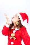 时尚圣诞节吹某事的Asain女孩照片  库存照片