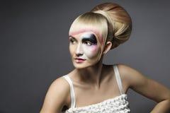 时尚妇女构成面具,艺术性的式样女孩组成 免版税库存照片