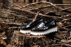 时尚广告穿上鞋子照片 图库摄影