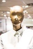 时尚时装模特塑料形式模型给衬衣Sto的按钮穿衣 库存图片