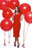 时尚样式妇女完善的身体形状深色的头发穿戴红色 库存图片
