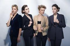 时尚样式的四个美丽的女孩 免版税库存照片