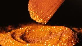 时尚金子发光的闪烁轻拍构成刷子 股票录像
