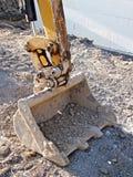 时段挖掘机的垂直 图库摄影
