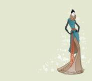 时装模特儿在冬天给草图看板卡穿衣 免版税库存照片