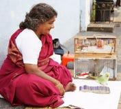 时运印地安人出纳员 免版税库存照片