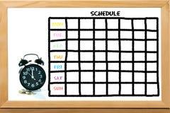 时钟和硬币与日程表 免版税库存图片