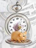 时钟和货币 库存照片