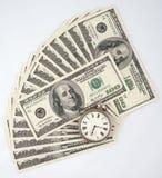 时钟堆货币 图库摄影