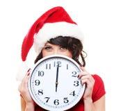 时钟女孩圣诞老人 免版税图库摄影