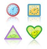 时钟的明亮的多彩多姿的不同的形式有反射的 免版税库存照片