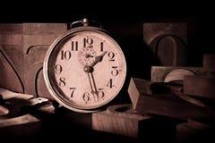 时钟老印刷术 库存图片