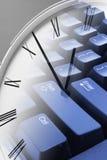 时钟计算机键盘 免版税库存照片