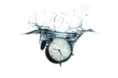 时钟飞溅 免版税图库摄影