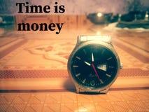 时间是金钱墙纸 免版税图库摄影