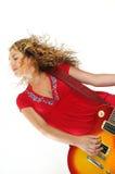 时髦女性的吉他弹奏者 免版税库存图片