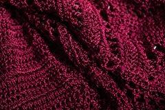 时髦的伯根地被编织的布料材料的样式 免版税库存图片