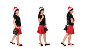 时髦的圣诞节女孩摆在白色的汇集 免版税库存图片