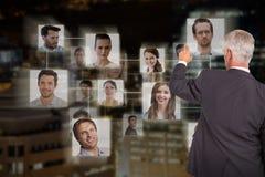 时髦的成熟商人背面图的综合图象指向手指的  免版税库存图片