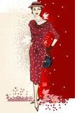 时髦的时尚有红色礼服的加工好的女孩 免版税库存图片