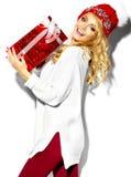 时髦的衣裳的愉快的甜逗人喜爱的微笑的白肤金发的妇女 图库摄影