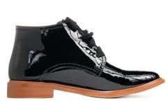 时髦的黑色漆革妇女脚腕启动 免版税库存图片