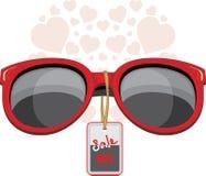 时髦红色太阳镜 销售额 库存照片