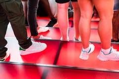 时代广场红色步、青年文化和旅游业概念 免版税图库摄影