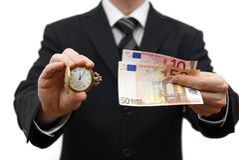 时间是与商人的金钱概念与金钱和口袋wat 库存照片