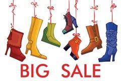 时兴的色的妇女的起动,鞋子 大销售额 免版税库存图片