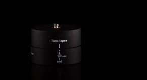 时间舔自转的设备在黑背景的360度 免版税图库摄影
