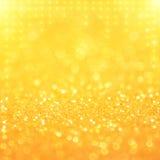 明亮和抽象被弄脏的桔子和金bokeh背景 库存照片