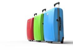 明亮地色的聚碳酸酯纤维旅行手提箱 库存照片