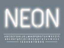 明亮的发光的白色霓虹灯广告字符 与焕发光的向量字体在并且编号灯上写字 库存例证