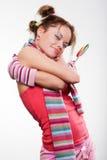 明亮的女孩棒棒糖面带笑容 免版税图库摄影