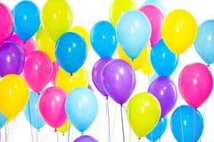 明亮的束五颜六色的气球背景 图库摄影