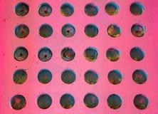 明亮的桃红色木小钉板 免版税库存照片