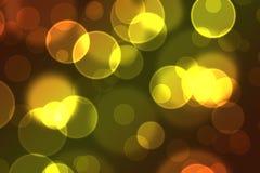 在桔子和黄色的令人敬畏的数字式Bokeh作用 免版税库存图片