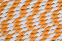 明亮的橙色纸秸杆背景 图库摄影