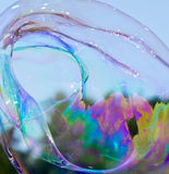 明亮的漩涡彩虹泡影纹理 库存图片