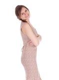 明亮的礼服的微笑的女孩 免版税库存图片