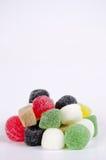 明亮的糖果颜色心满意足的棍子糖甜点 库存照片